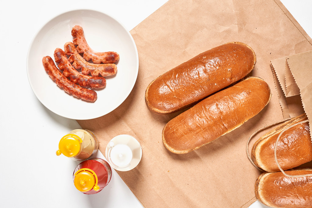 Top view of hotdog ingredients on white table