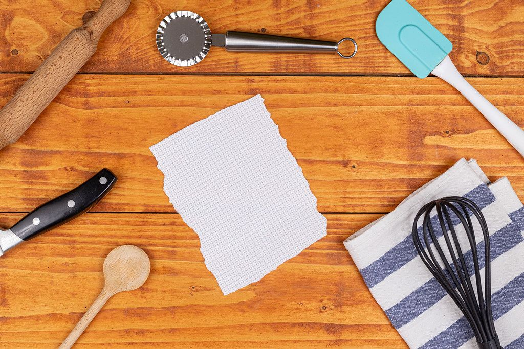 Top view of Kitchen Utensils with copy space above white paper
