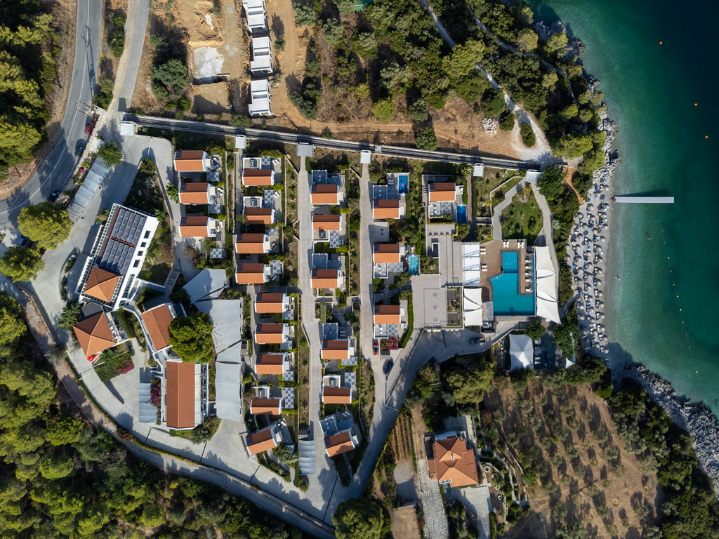 Top view of luxurious hotel at Panormos bay with a complex of villas and swimming pool: Adrina Resort & Spa