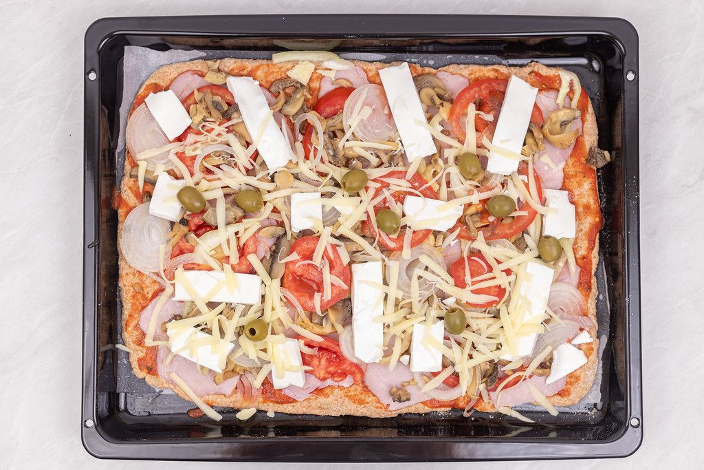 Top view of Raw Vegetables Pizza with Whole Wheat Flour