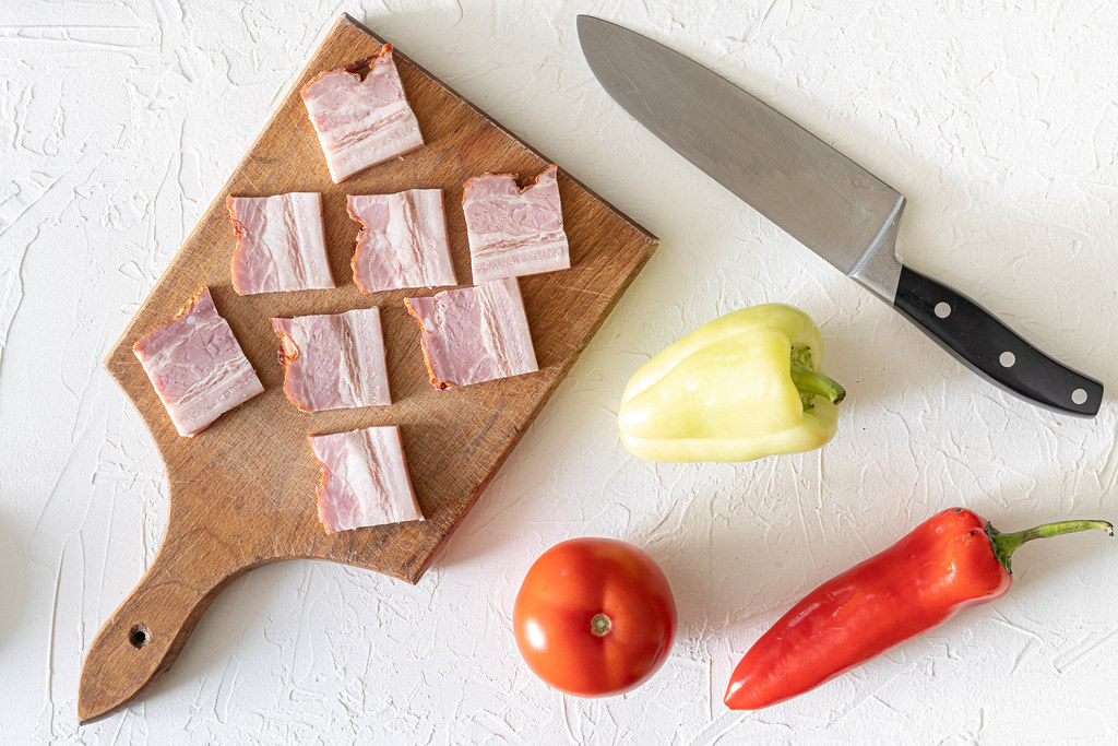 Top view of sliced Bacon with Vegetables