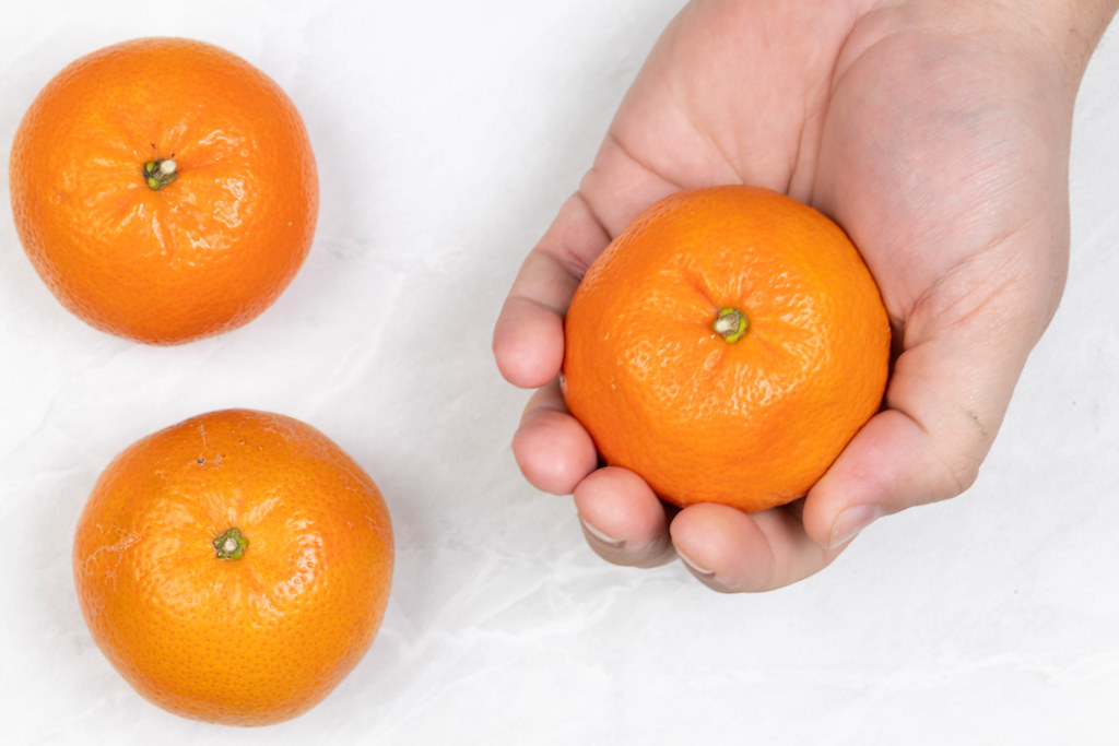 Top view of Tangerines in the hand