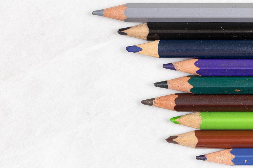 Top view of Wooden Color Pencils with copy space above white background