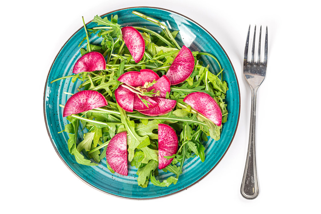 Top view, salad with red radish and arugula
