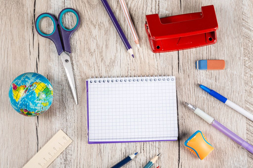 Top view, school things on a wooden background