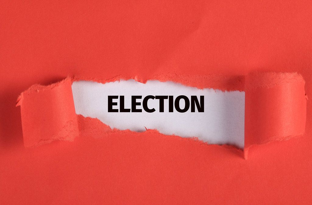 Torn paper revealing the word Election