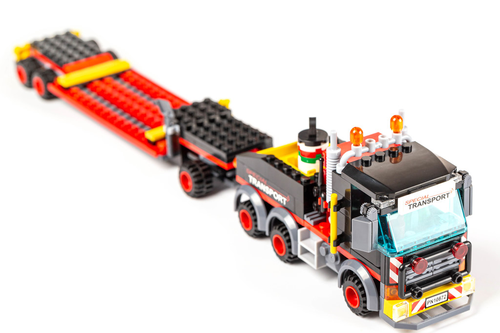 Toy colorful truck with trailer made of parts of the designer