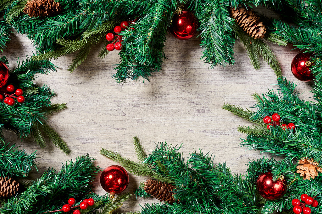 Traditional Christmas background with fir tree branches and Xmas tree decorations