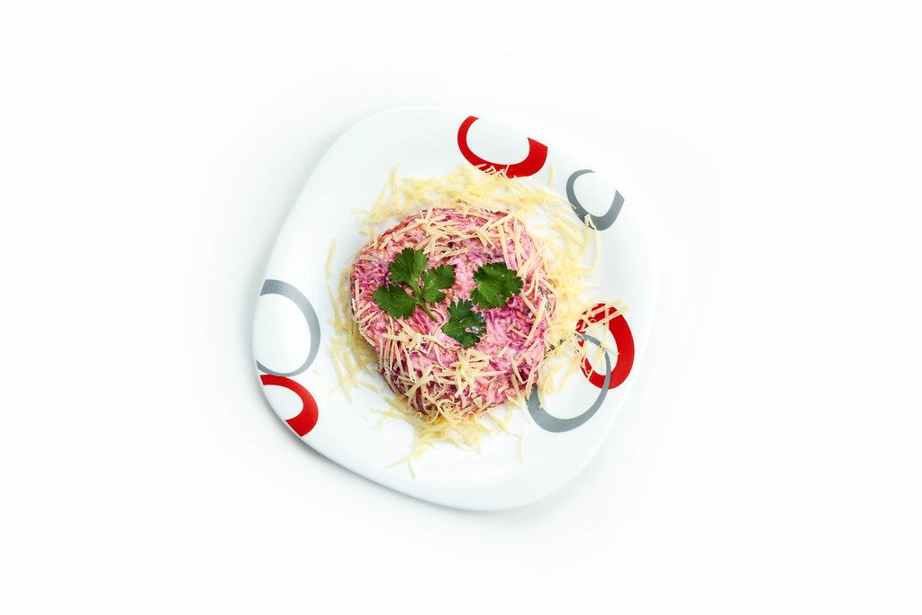 Traditional Russian salad Mimosa made of cheese, eggs, canned fish, onion, and mayonnaise