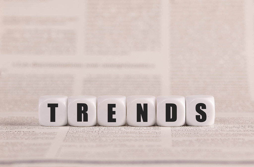 Trends written with cubes on a newspaper