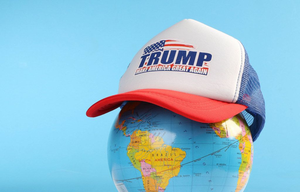Trump classic trucker hat on a globe