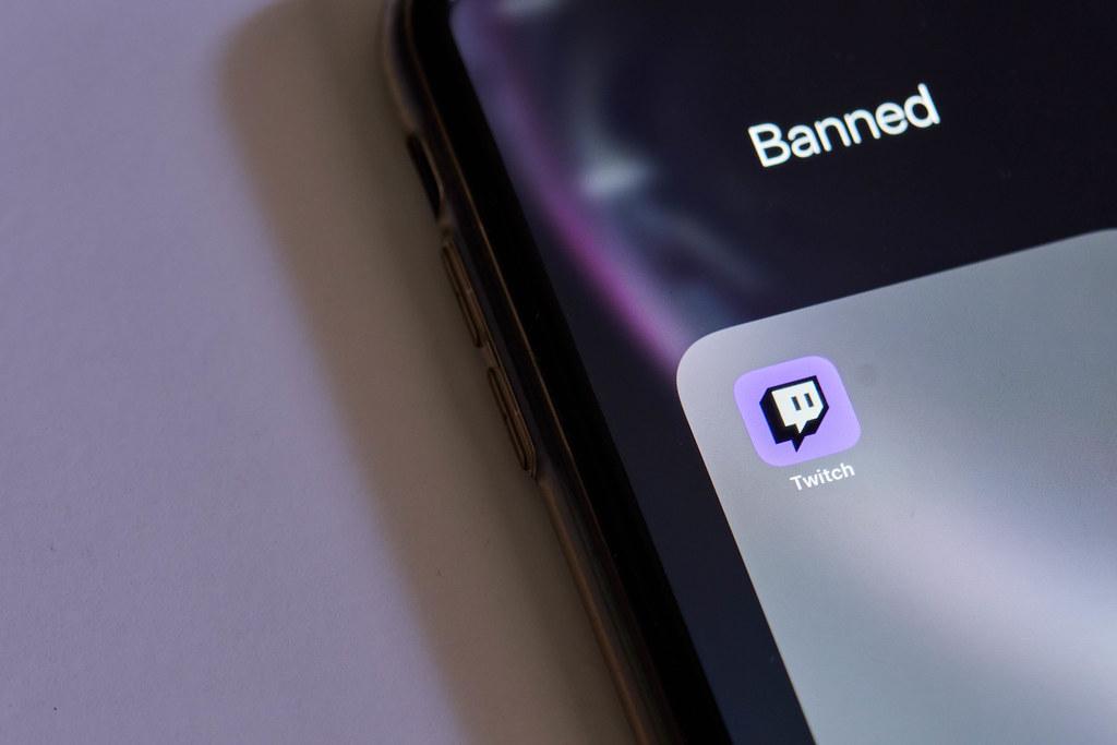 Twitch app logo in Banned folder on phone screen