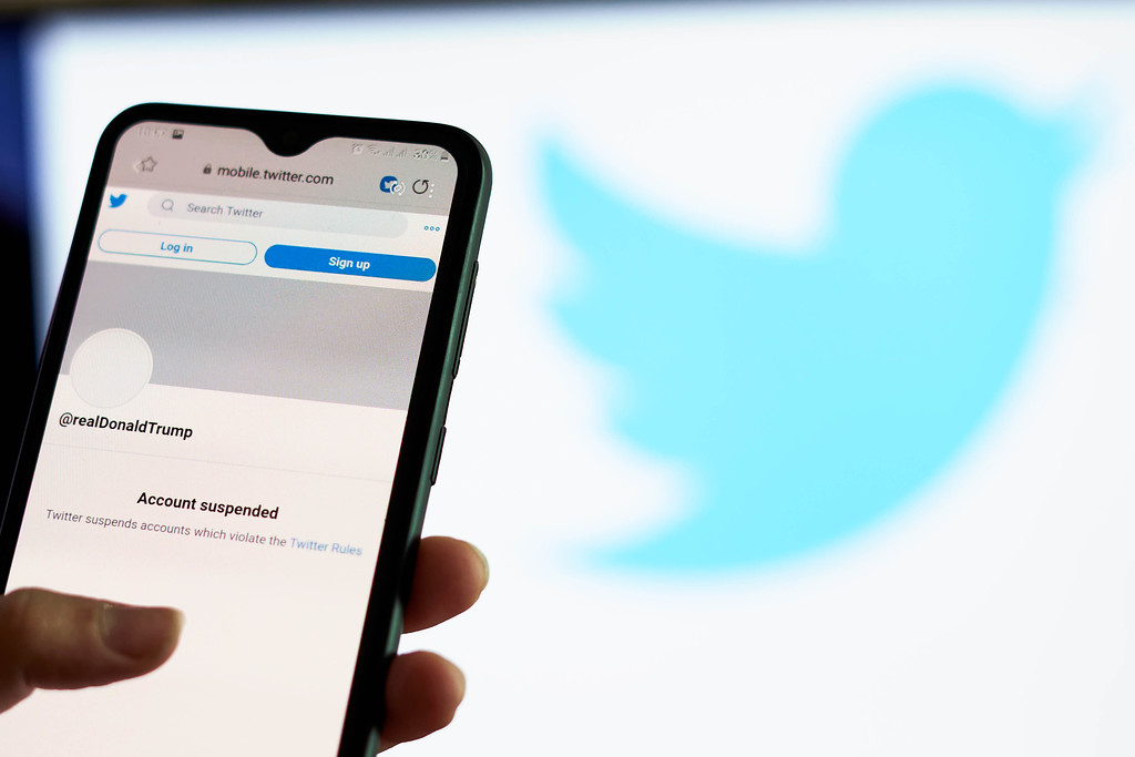 Twitter permanently bans Trump, capping online revolt
