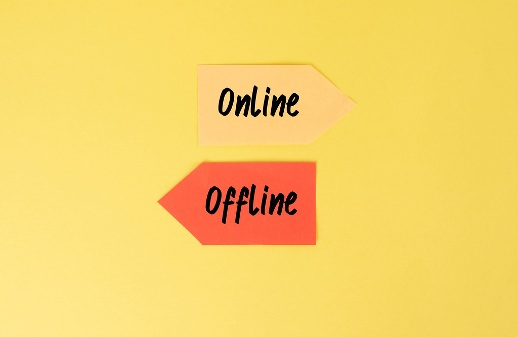 Two arrows with Online and Offline text on yellow background