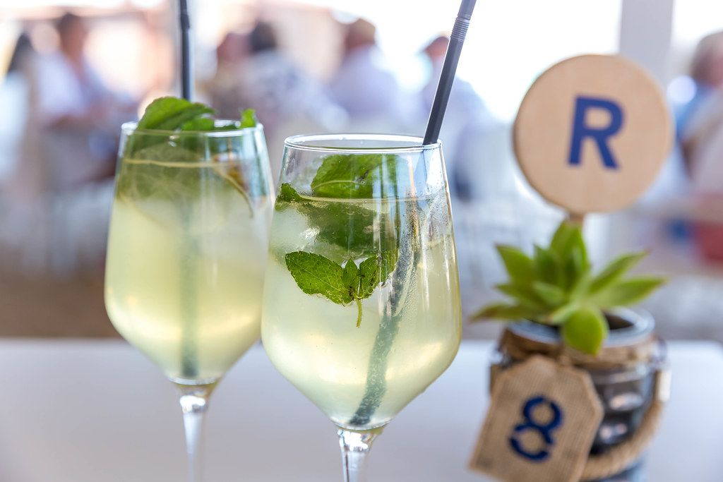 Two glasses of Hugo: light alcoholic cocktail made with Prosecco and served with fresh mint