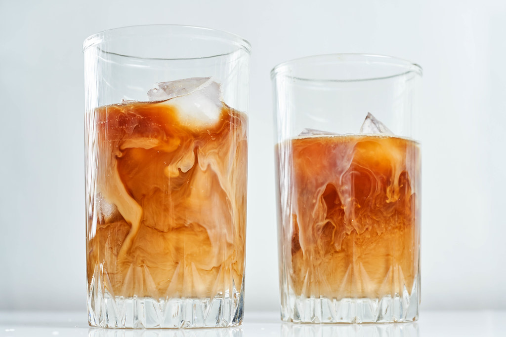 Two glasses of iced coffee with milk