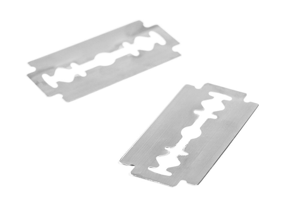 Two metal blades on a white background