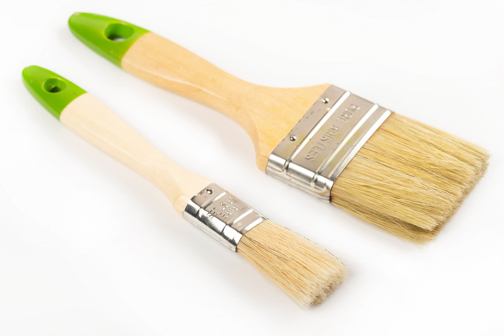 Two wooden brushes on a white background