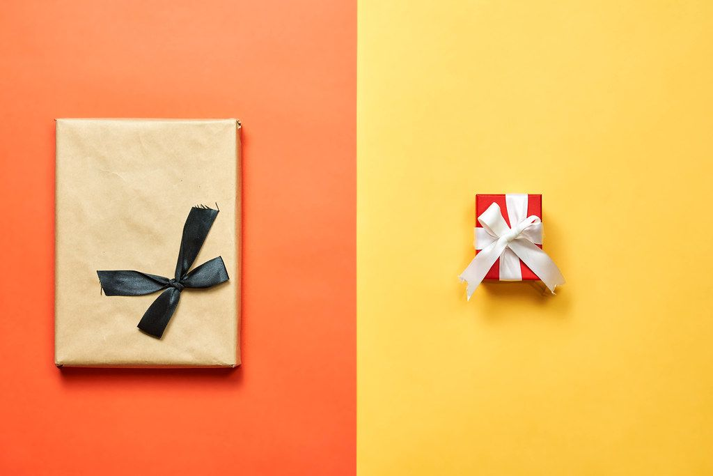 Two X-mas gifts on bright divided background