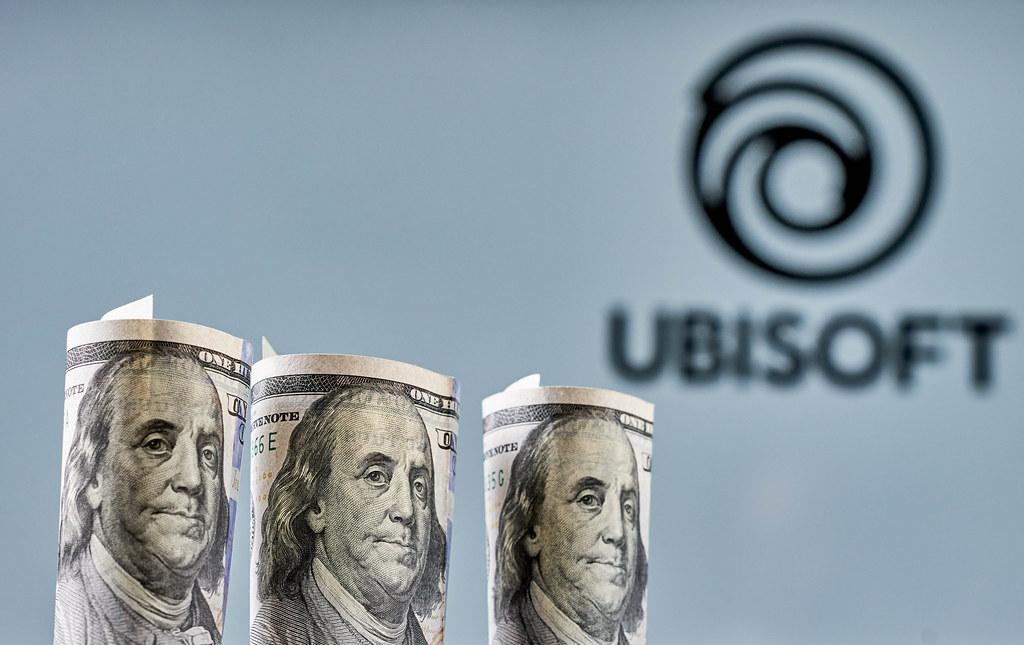 Ubisoft Entertainment - video game company logo and us dollar bills