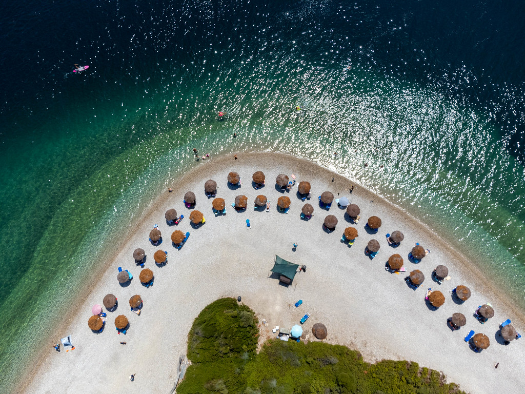 Uncrowded serviced beach in the high season on Alonnisos, Northern Sporades. Drone pic in summer 2021