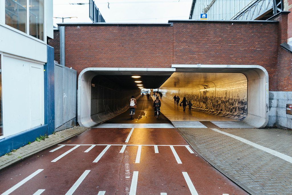 Underpass under the main train station in Amsterdam with 2 bike lanes and a sidewalk