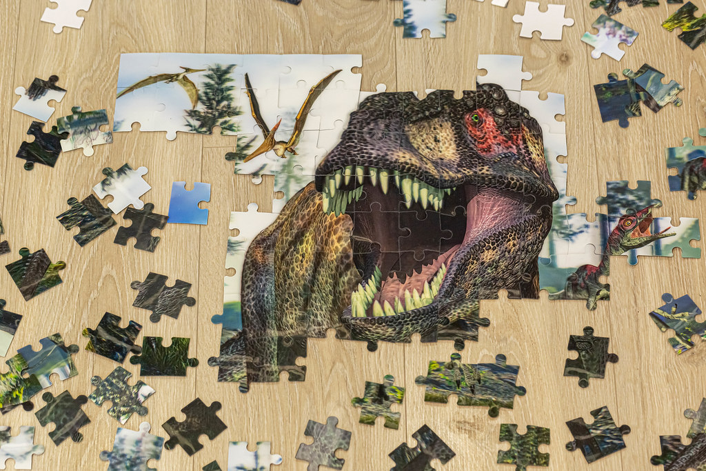 Unfinished build puzzles with a dinosaur