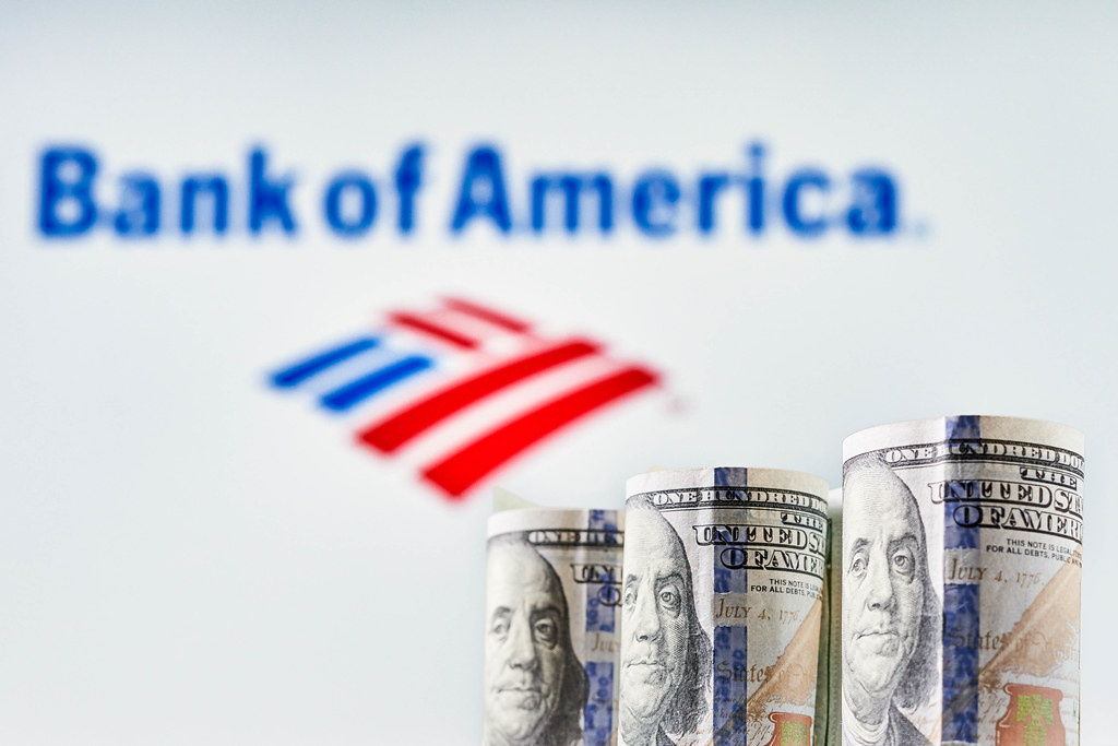US dollar bills and Bank of America logotype on the background