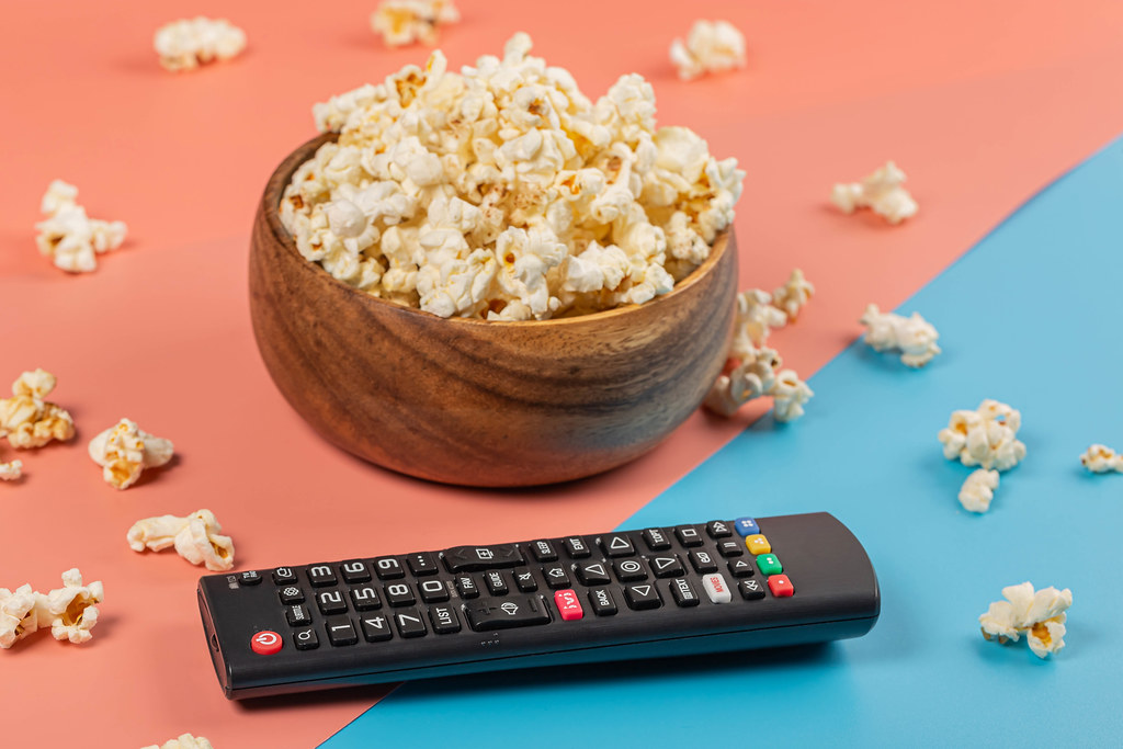 Vacation at home concept - popcorn and TV remote