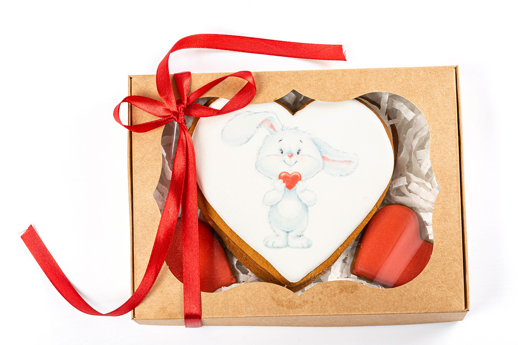 Valentine's day cookies in gift box on white background, top view