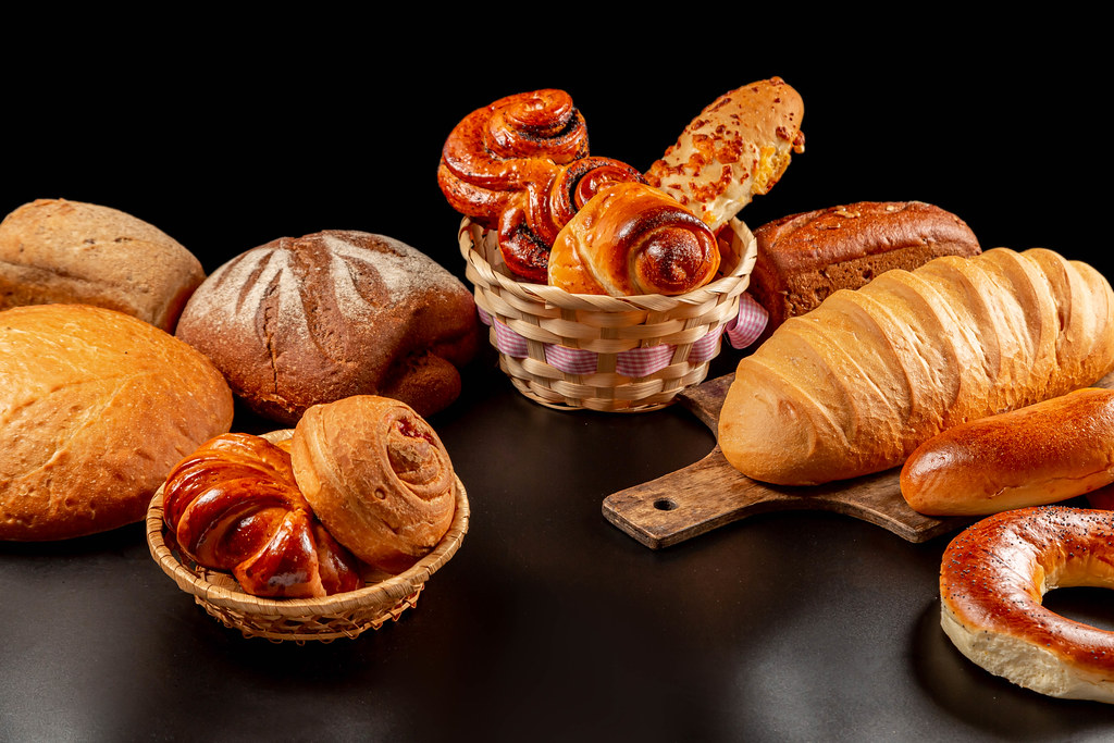 Variety of bakery products on dark background