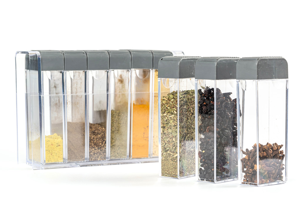Variety of spices over white background