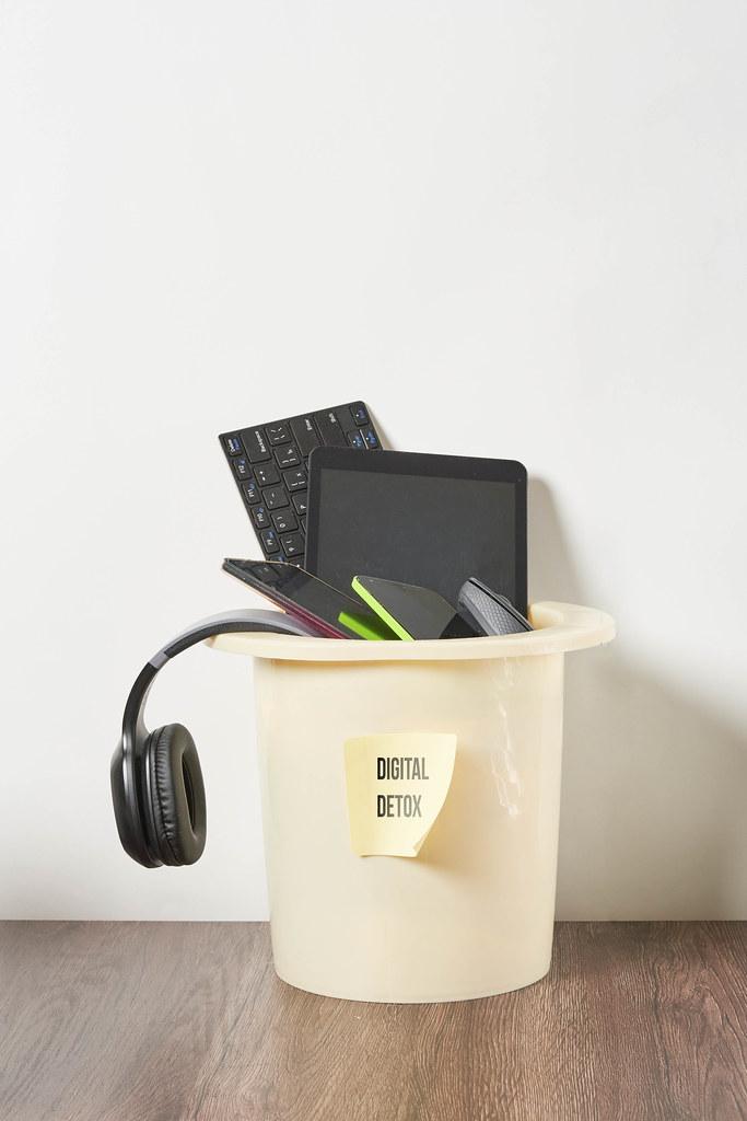 Various digital devices in the garbage bin. Digital detox