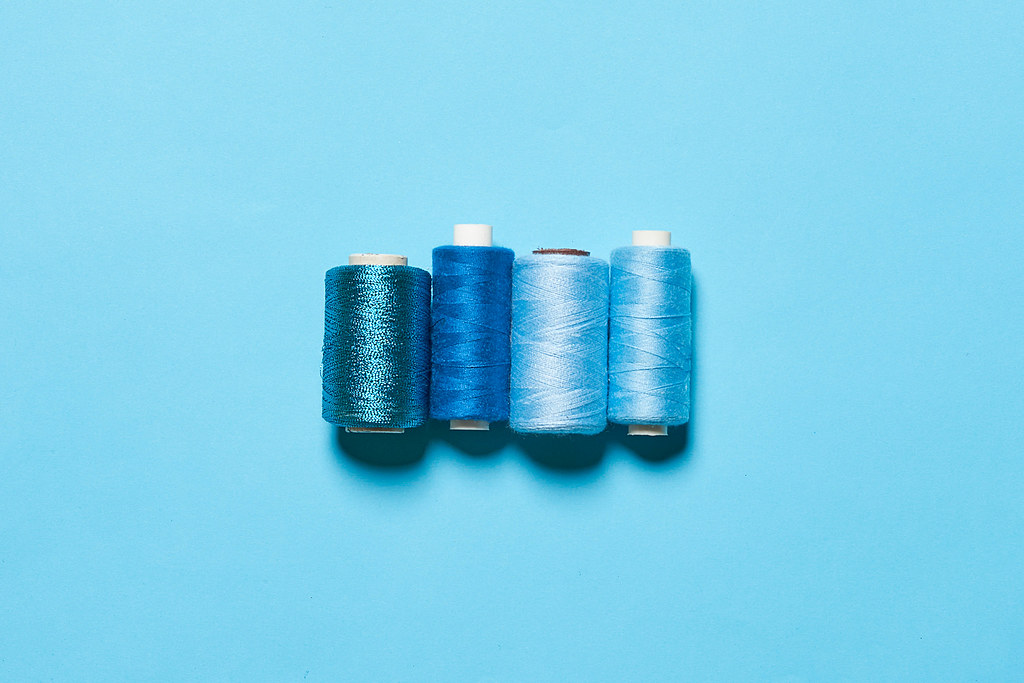 Various shades of blue thread spools
