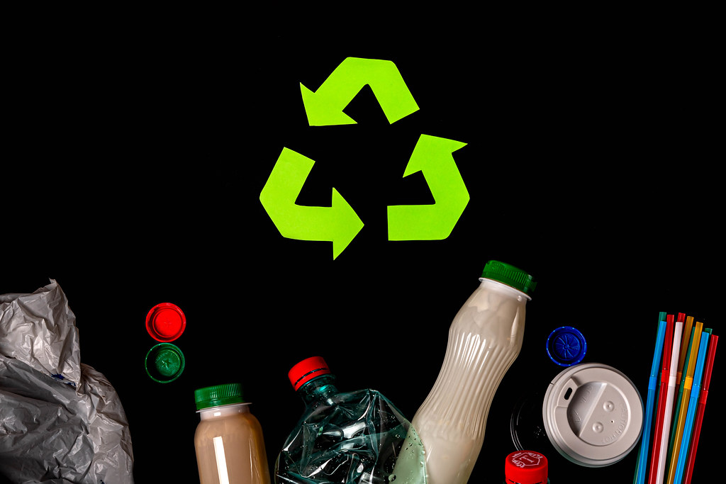 Various types of garbage and recycle sign on black