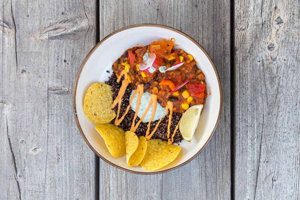 Vegan Mexican Tex-Mex stew with black beans and corn, quinoa and nachos. Villa Vegana on Mallorca