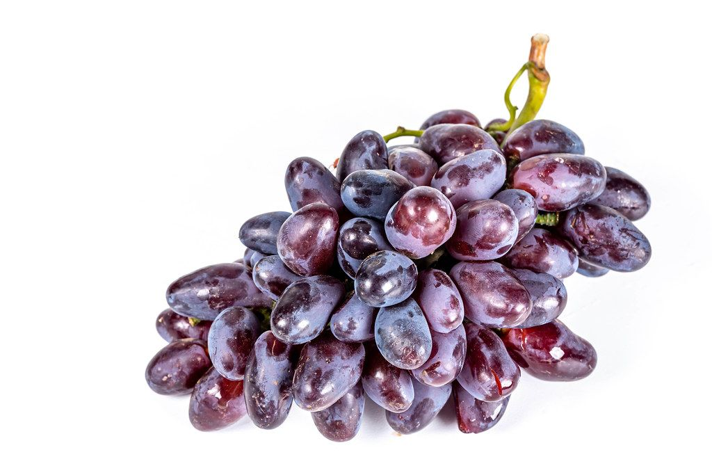 Velvet red grapes on white background