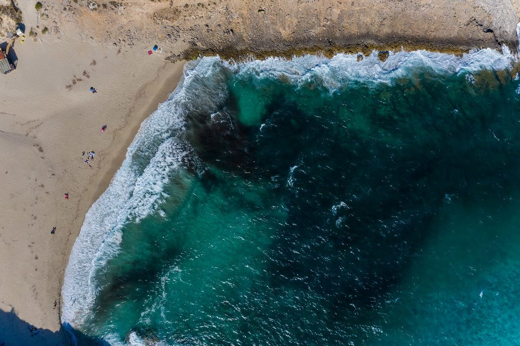 Very few people on the beach of Cala Torta in Mallorca near Artà in summer 2020. Aerial view