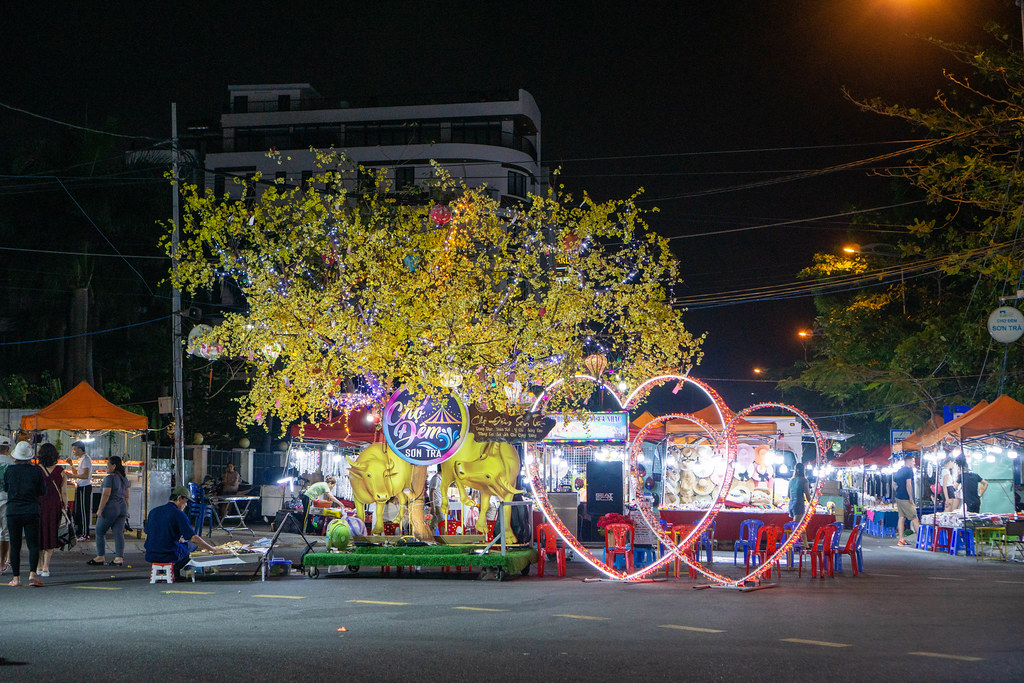 Vietnamese New Year of the Ox Decorations with Hearts and Peach Blossom Tree at Son Tra Night Market in the City Center of Da Nang, Vietnam