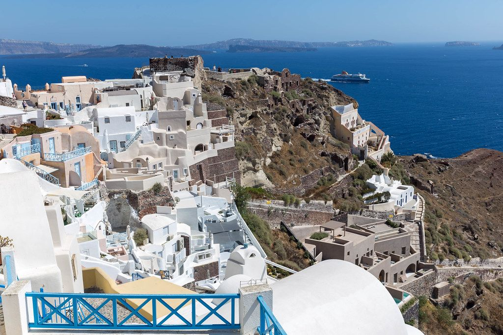 View from a terrace with the Aegean Sea and the village of Oia in Santorini, Greece on a summer day