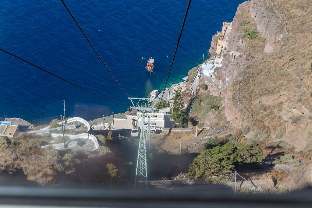 View from the cable car looking down towards the old port and the deep blue Aegean Sea in Santorini