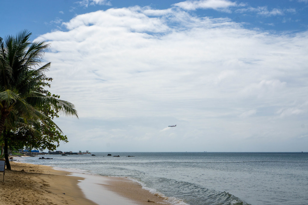 View of a Plane landing at Phu Quoc International Airport from the Beach at Istanbul Beach Club on Phu Quoc Island, Vietnam