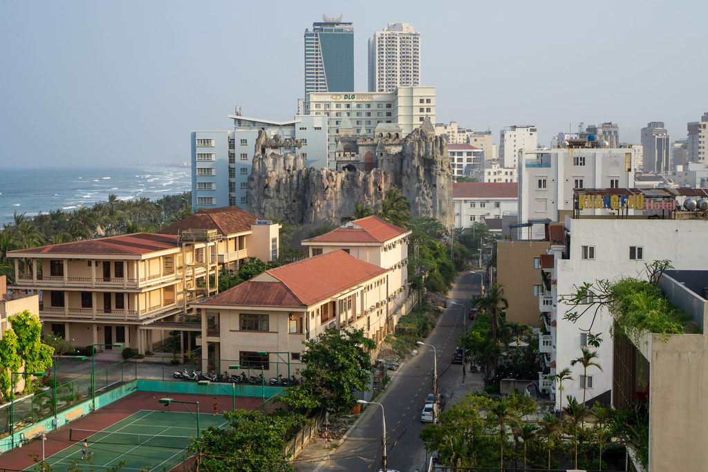 View of My Khe Beach, Tennis Court, Buildings and a Castle on top of a Large Rock in Da Nang, Vietnam
