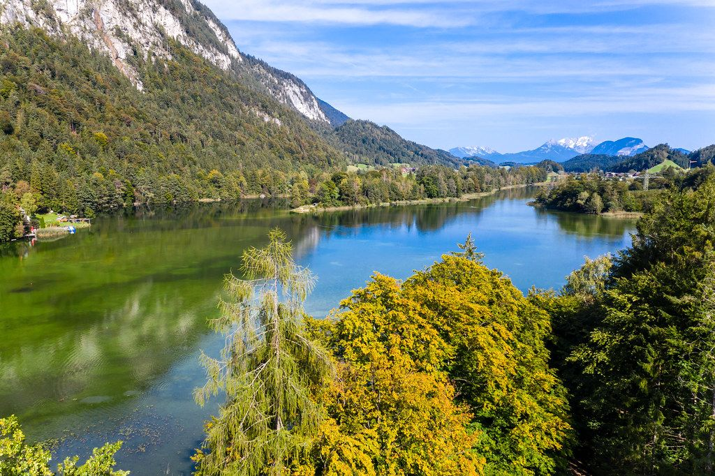 View of the Reintalersee with the Brandenberger Alps. Drone shot of autumn landscape in Tyrol