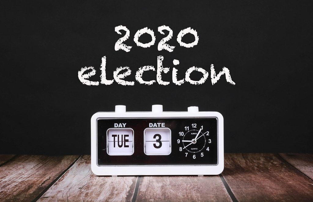 Vintage clock with calendar showing 2020 election date