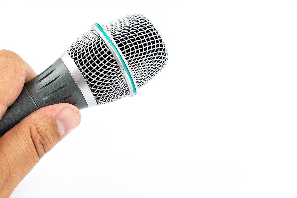 Vocal Microphone head in the hand with copy space