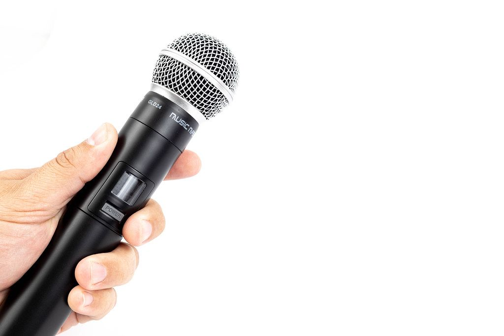 Vocal Microphone in the hand with copy space
