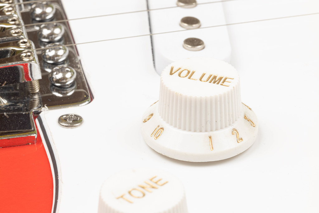 Volume Knob on the Guitar with blurred background