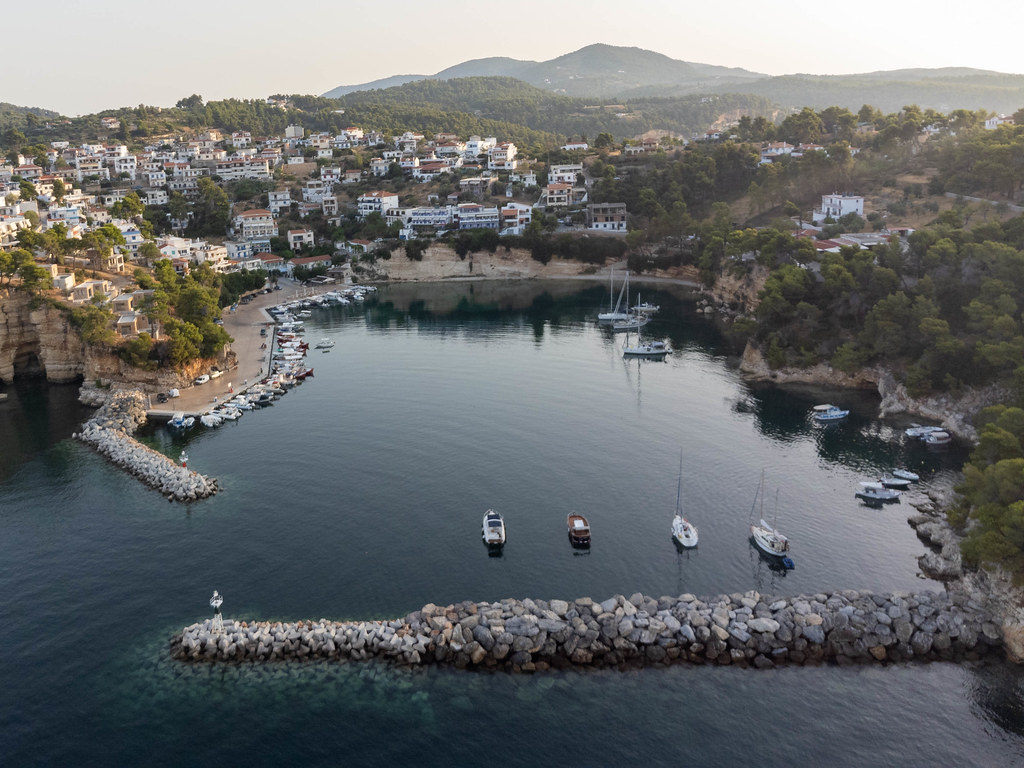 Votsi port and village in the early morning light on Alonnisos, Greece. Drone photo