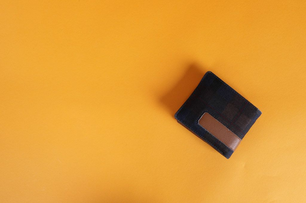 Wallet on orange background with copy space